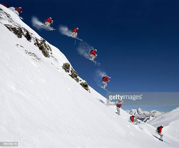 sequence of male skier jumping down steep slope (digital composite) - downhill skiing stock pictures, royalty-free photos & images