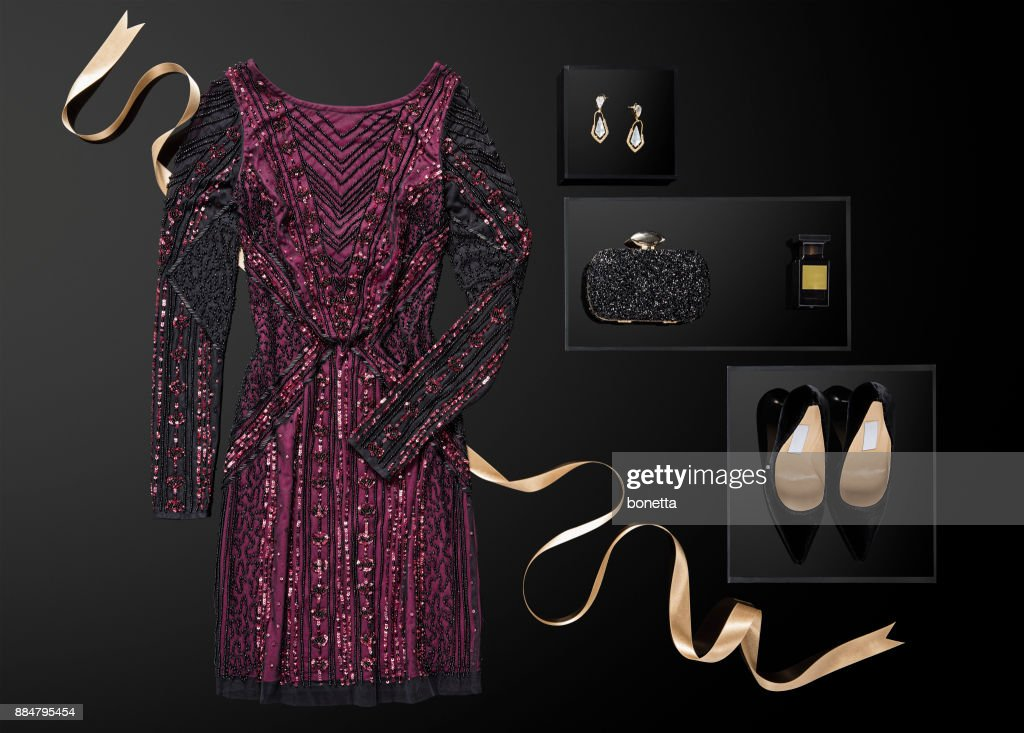 Sequin dress with personal accessories isolated on black background : Stock Photo
