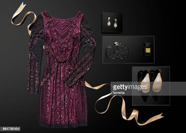 sequin dress with personal accessories isolated on black background - evening gown stock pictures, royalty-free photos & images