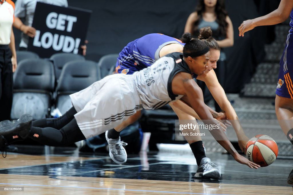 Sequoia Holmes #17 of the San Antonio Stars jumps for possession of the ball against the Phoenix Mercury on May 19, 2017 at AT&T Center in San Antonio, Texas.