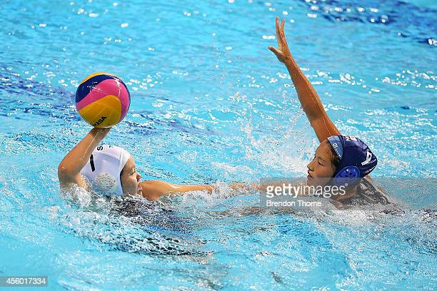 Ser Han Neo of Singapore competes with Yumi Kojo of Japan in the Women's Single Round Robin Waterpolo during day five of the 2014 Asian Games at...