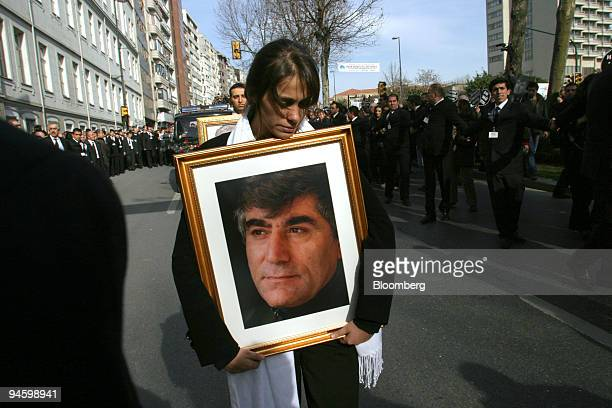 Sera Dink daughter of murdered Turkish Armenian journalist Hrant Dink carries a portrait of her father leading the cortege on its way to the cemetery...