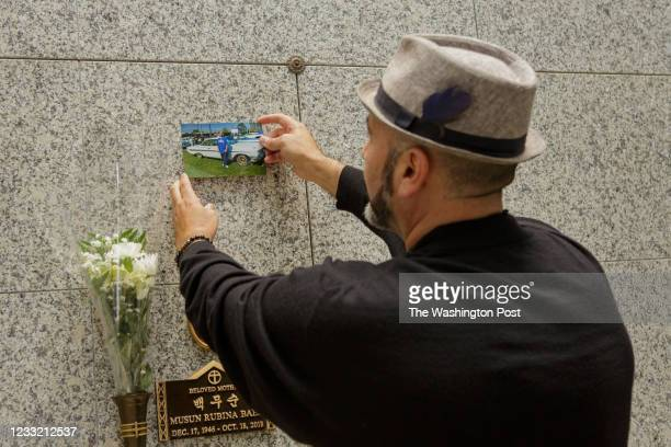 Serafin Serrano posts a photo of Ernie Serrano on his tomb while the family waits for his plaque to be completed.