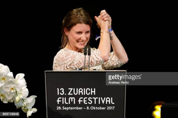 Seraina Nyikos gives her acceptance speech after receiving the Treatment Award on stage during the Award Night Ceremony during the 13th Zurich Film...
