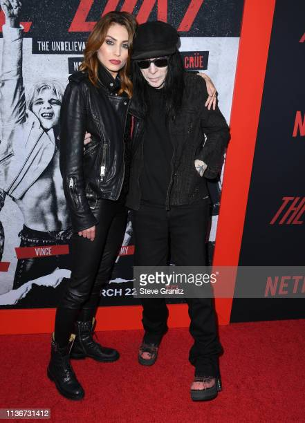 Seraina Schönenberger and Mick Mars arrives at the Premiere Of Netflix's 'The Dirt' at ArcLight Hollywood on March 18 2019 in Hollywood California