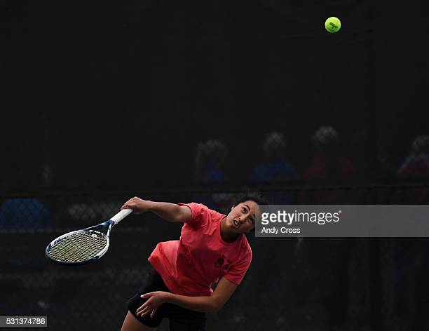 Seraphin Castelino Fairview serves to opponent Ky Ecton Poudre during the girls 5A Colorado State tennis championship at the Gates Tennis Center May...