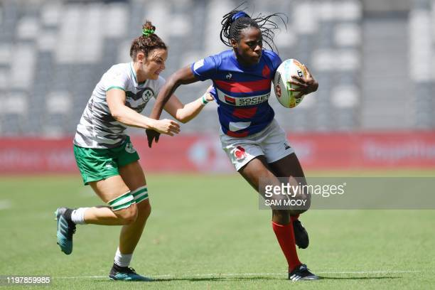 Seraphine Okemba of France handsoff Ireland's Jordan Conroy during the Sydney Sevens rugby tournament at Bankwest Stadium in Sydney on February 1...