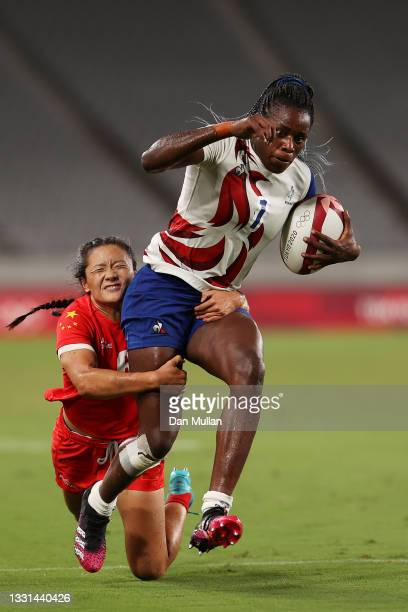 Seraphine Okemba of Team France scores a try while being is tackled by Wanyu Wang of Team China in the Women's Quarter Final match between Team...