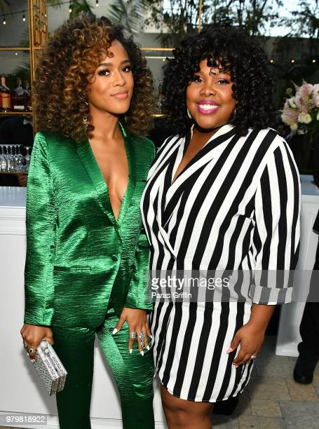 Serayah McNeill and Amber Riley attends the Debra Lee PreBET Awards Dinner at Vibiana on June 20 2018 in Los Angeles California
