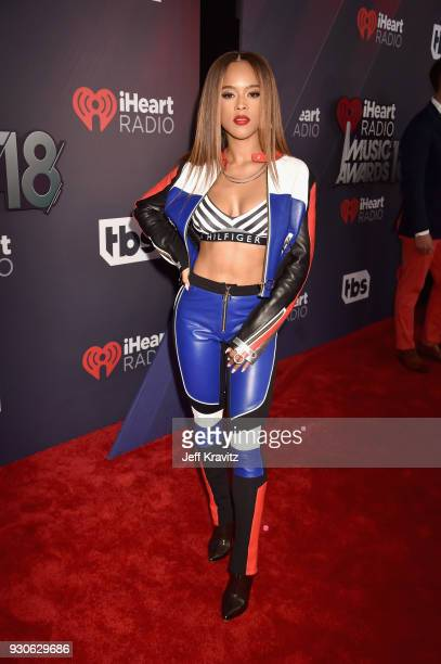 Serayah McNeill arrives at the 2018 iHeartRadio Music Awards which broadcasted live on TBS TNT and truTV at The Forum on March 11 2018 in Inglewood...