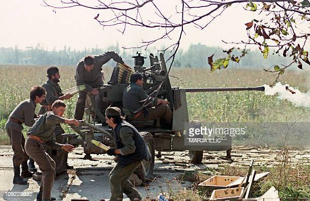 Serb volunteers load a cannon on the front line during the fighting for Vukovar against the Croatian forces 05 October 1991 in Borovo Selo AFP PHOTO...
