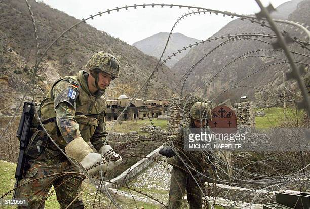 Soldiers of the Bundeswehr build up a road block near the Archangel Monastery in Sredska near Prizren 22 March 2004 600 German extra soldiers among...