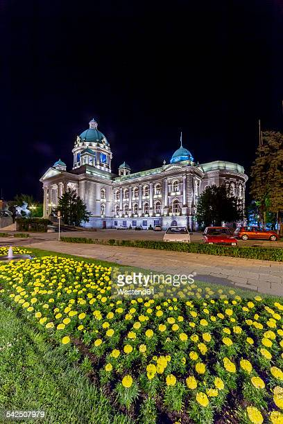 serbia, belgrade, savski venac, parliament building at night - belgrade serbia stock photos and pictures