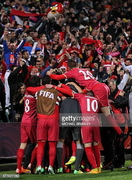 Serbia celebrate a goal with their fans during the FIFA Under20 World Cup football semifinal match between Serbia and Mali in Auckland on June 17...