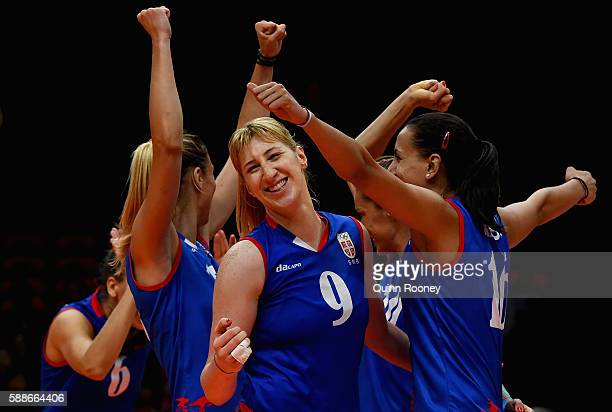 Serbia celebrate winning a point during the Women's preliminary volleyball match between Serbia and China on Day 7 of the Rio 2016 Olympic Games at...