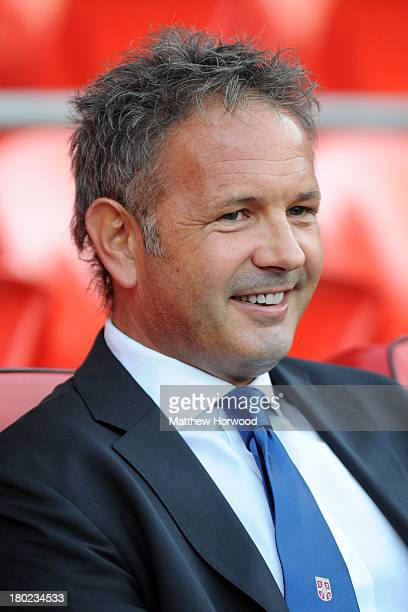 Serbia coach Sinisa Mihajlovic looks on during the FIFA 2014 World Cup Qualifier Group A match between Wales and Serbia at Cardiff City Stadium on...