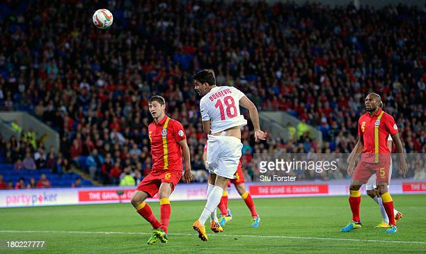 Serbia forward Filip Dordevic heads in the opening goal during the FIFA 2014 World Cup Qualifier Group A match between Wales and Serbia at Cardiff...