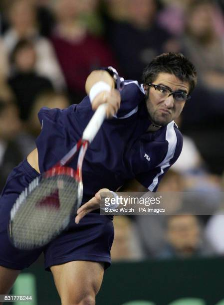 Serbia Montenegro's Janko Tipsarevic in action with Great Britain's Greg Rusedski during the first day of the Davis Cup at the Braehead Arena Glasgow...