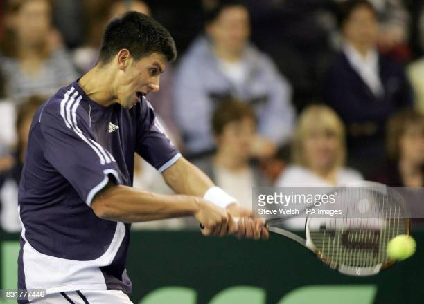Serbia Montenegro's Novak Djokovic in action against Great Britain's Arvind Parmar during the Davis Cup match at the Braehead Arena Glasgow Friday...