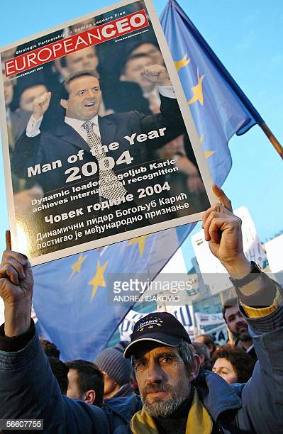 Serbia Movement's supporter holds a picture of Serbia's richest tycoon and leader of the party Bogoljub Karic during a rally in downtown Belgrade 17...