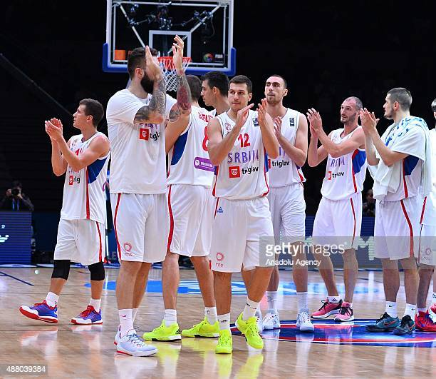 Serbia National Basketball team celebrate after the the EuroBasket 2015 Round of 16 match between Serbia and Finland at the Pierre Mauroy Stadium in...
