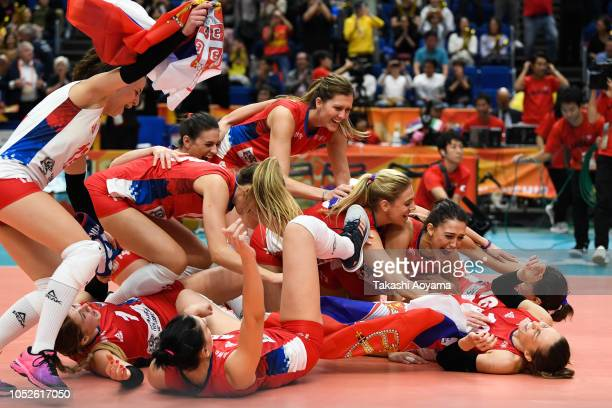 Serbia players celebrate after defeating Italy during the FIVB Women's World Championship final between Serbia and Italy at Yokohama Arena on October...