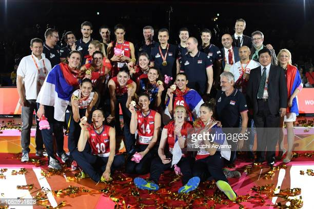 Serbia players celebrate with the trophy after defeating Italy during the FIVB Women's World Championship final between Serbia and Italy at Yokohama...