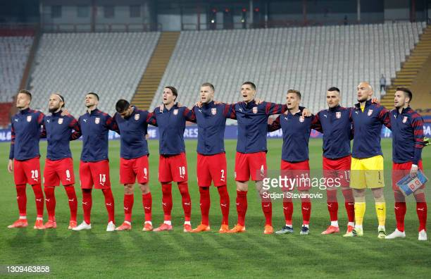 Serbia players sing the national anthem during the FIFA World Cup 2022 Qatar qualifying match between Serbia and Portugal at FK Crvena Zvezda stadium...