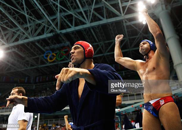 Serbia substitutes celebrate after winning the Men's Water Polo Semi Final match between Italy and Serbia at the Olympic Aquatics Centre on day 13 of...