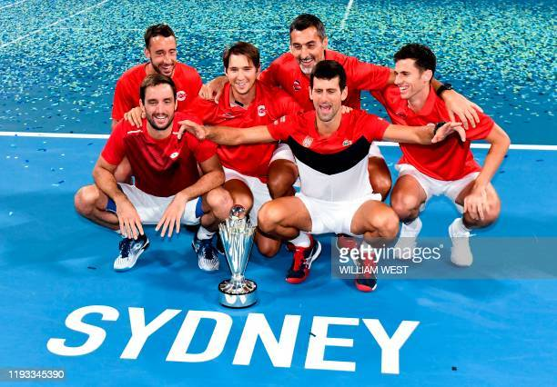 Serbia team celebrate with the trophy after defeating Spain in the final of the ATP Cup tennis tournament in Sydney on January 13 2020 / IMAGE...