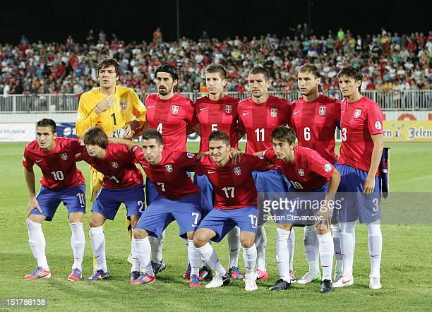Serbia team players line up for a team photograph prior the FIFA 2014 World Cup Qualifier at stadium Karadjordje Park between Scerbia and Wales on...