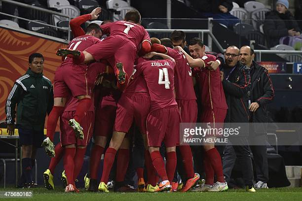 Serbia teammates celebrate a goal during the FIFA Under20 World Cup football match between Serbia and Mali in Dunedin at Otago Regional Stadium on...