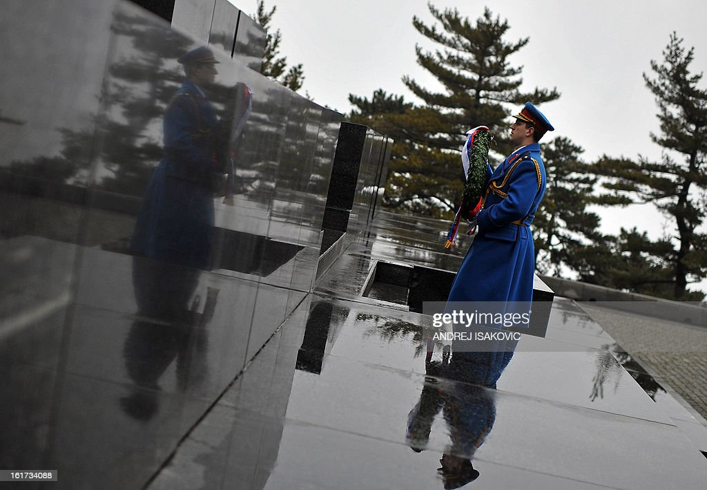 A Serbian Army soldier carries a wreath during a ceremony at the monument of the Unknown Soldier on mount Avala near Belgrade, on February 15, 2013, on Serbia's Statehood Day, a celebration of the 209th anniversary of the first Serbian uprising and the creation of the modern Serbian state.