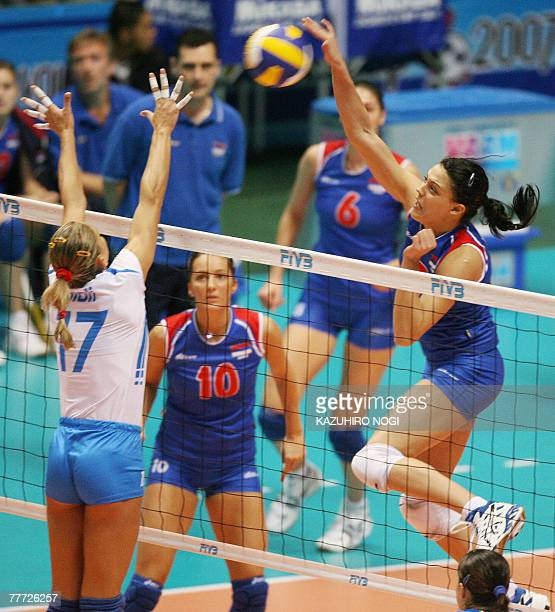 Serbian attacker Stefana Veljkovic spikes the ball over Simona Gioli during their second round match at the women's World Cup volleyball tournament...