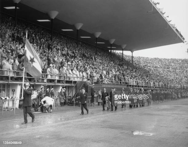Serbian decathlete Oto Rebula is the flag bearer leading the Yugoslavian Olympic team at the opening ceremony of the 1952 Summer Olympics at the...