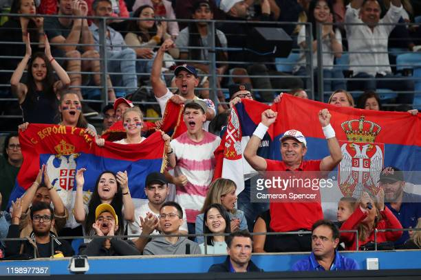 Serbian fans celebrate during the final singles match between Dusan Lajovic of Serbia and Roberto Bautista Agut of Spain on day 10 of the ATP Cup at...