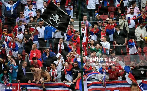 Serbian fans cheer up their team during a friendly football match between Serbia and NewZealand in the Hypo Arena Wörthersee Stadium of Klagenfurt on...