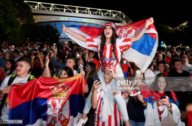 Serbian fans of Novac Djokovic celebrate his win in the Men's Final during day 14 of the 2019 Australian Open at Melbourne Park on January 27 2019 in...