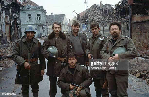 Serbian fighters stand among the ruins of Vukovar after a threemonth battle between the Croatian armed forces and the Yugoslavian Federal Army which...
