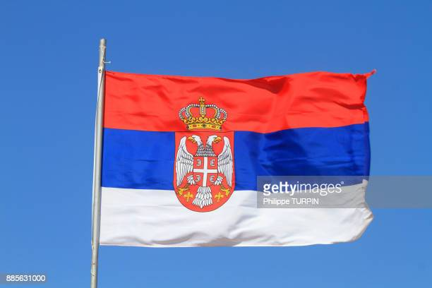 Serbian flag in blue sky.