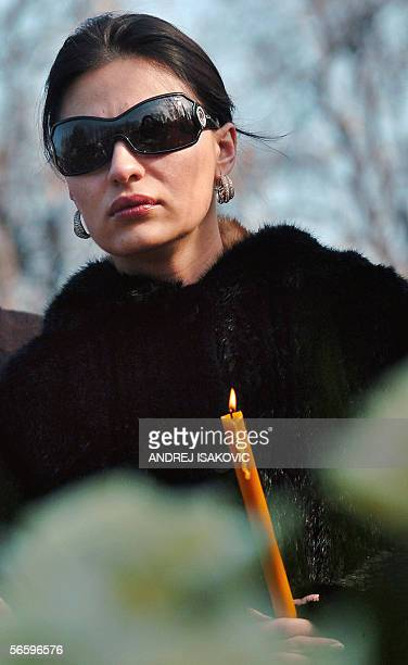 Serbian folk singer Svetlana Raznatovic the widow of notorious warlord Zeljko RaznatovicArkan holds a candle during a memorial service in Belgrade's...