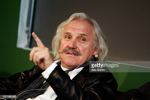 Serbian football coach Dragoslav Stepanovic gestures during a public viewing of the FIFA 2010 World Cup match of Germany and Serbia in a shopping...