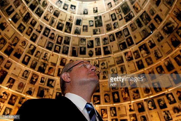 Serbian Foreign Minister Ivan Mrkic looks at pictures of Jewish Holocaust victims at the Hall of Names on November 13 2012 during his visit to the...