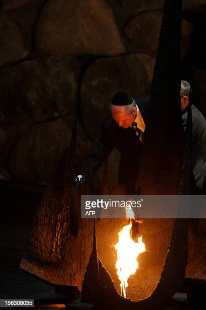 Serbian Foreign Minister Ivan Mrkic rekindles the eternal flame at the Hall of Remembrance on November 13 during his visit to the Yad Vashem...