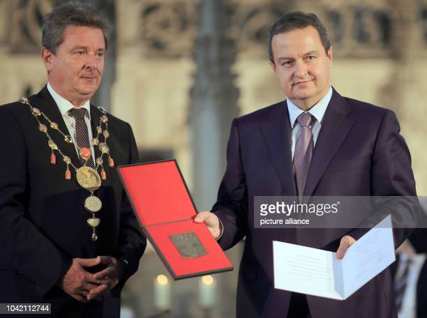 Serbian Foreign Minister Ivica Dacic current chairman of the Organization for Security and Cooperation in Europe poses with Magdeburg's senior mayor...