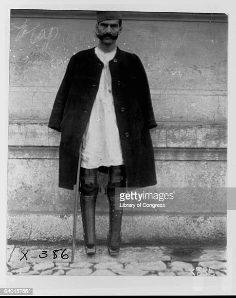 Serbian former soldier stands on his two artificial legs in Belgrade after being returned from an Austrian prisoner-of-war camp.