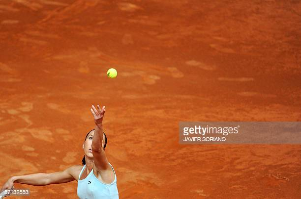 Serbian Jelena Jankovic serves to her opponent Slovakian Daniela Hatunchova during their match of the WTA Madrid Open claycourt tournament on May 12...