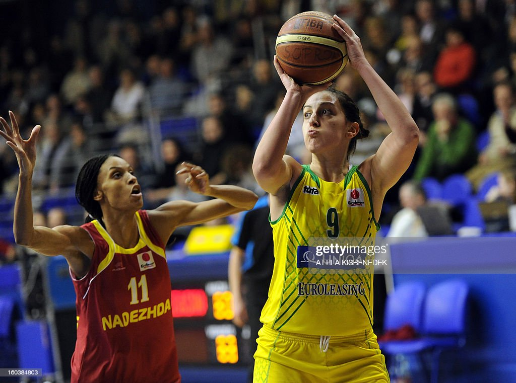 Serbian Jelena Milovanovic (R) of Hungarian UE Sopron scores her basket against Dewanna Bonner of Russian Nadezhda Orenburg on January 30, 2013 during their basketball EuroLeague match in Sopron, Hungary.