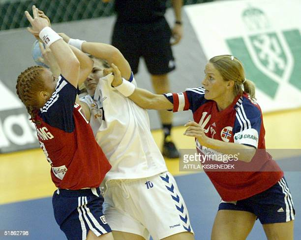 Serbian Maja Lojpur fights for the ball with Norway's Karoline Breivang and Gro Hammerseng during a mainround match at the 6th European Women's...