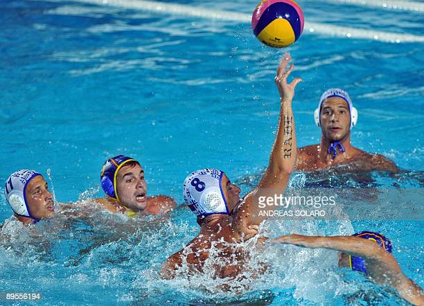 Serbian Milan Aleksic fights for the ball against Spain during the Men's waterpolo GoldMedal match on August 1 2009 at the FINA World Swimming...